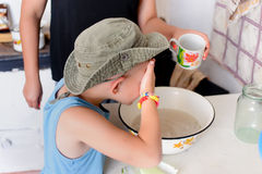 Thirsty Cute Young Boy Drinking Water on a Glass Stock Images
