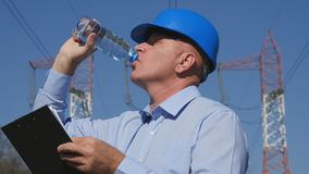 Thirsty Engineer Electrician Work and Drink Fresh Water. Image with Thirsty Engineer Electrician Work and Drink Fresh Water royalty free stock photo