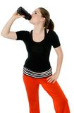 Thirsty Exercise. Young caucasian girl drinking from an exercise bottle Stock Image