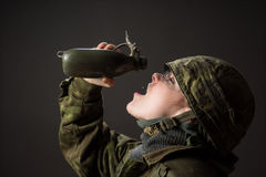 Thirsty female soldier Stock Photography