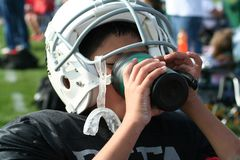 Thirsty football player. Drinking refreshment Stock Photo