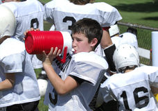Thirsty Football Player Royalty Free Stock Photos
