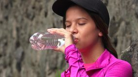 Thirsty Girl Drinking Bottled Water stock footage