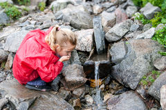 Thirsty girl drinking water Stock Image