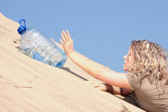Thirsty girl looking for water Stock Photography