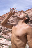 Thirsty hiker in desert Stock Photography