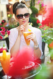 Thirsty lady drinking an orange juice Royalty Free Stock Images