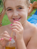 Thirsty little girl Royalty Free Stock Photography