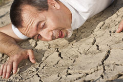 Thirsty man in a desert Stock Photography