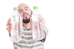 Thirsty man holding two bottles of cold water Stock Photo