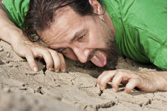 Thirsty man on parched soil stock photo