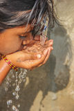 Thirsty. Rural girl Drinking Tap water Royalty Free Stock Photos