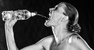 Thirsty Sporty Woman Drinking Water from a Bottle Royalty Free Stock Photo