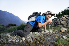 Thirsty tourist hiker in india mountains Stock Photo