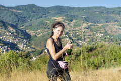 Thirsty tourist  Woman Drinking Water in the autumn mountain Stock Images