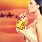 Thirsty woman drink pineapple juice atesert Stock Photo
