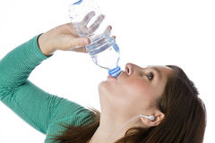 Thirsty woman drinking Royalty Free Stock Images
