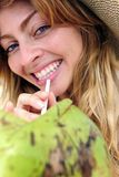 Thirsty woman drinking coconut water, close-up. Thirsty blond woman drinking coconut water, close-up Stock Photography