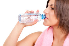 Thirsty woman drinking water stock image