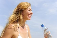 Thirsty woman drinking water outdoors Stock Photos