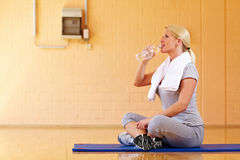 Thirsty woman with water Royalty Free Stock Image