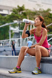Thirsty woman water bottle Stock Images