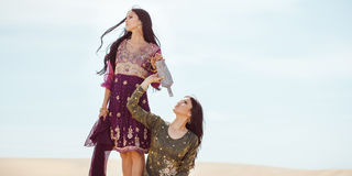 Thirsty women traveling in desert. Lost in desert durind sandshtorm stock photography