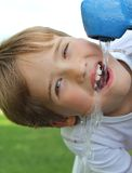 Young boy drinking water closeup stock photos