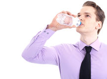 Thirsty young businessman Stock Photography