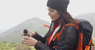 Thirsty young woman backpacker stock footage