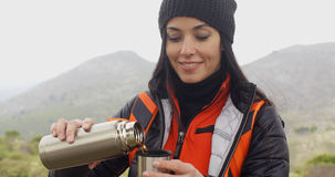 Thirsty young woman backpacker Royalty Free Stock Photography