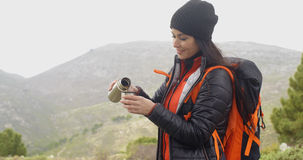 Thirsty young woman backpacker Royalty Free Stock Photo
