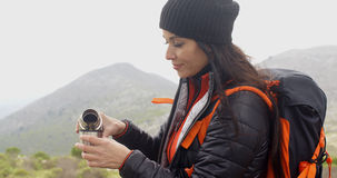 Thirsty young woman backpacker Royalty Free Stock Image
