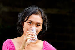 Thirsty young woman drinking pure mineral water Royalty Free Stock Photography