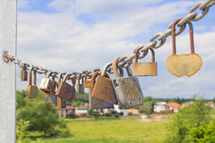 Thirteen rusty locks on a thick galvanized chain Royalty Free Stock Photos