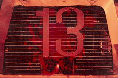 13 thirteen unlucky number with grunge blood stain. Front of truck stock images