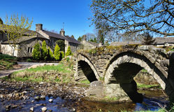 Thirteenth century packhorse bridge and the Stock Image