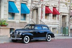Thirties sedan parked in New York style neighborhood. Black thirties sedan parked on New York style neighborhood street Stock Photography