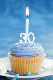 Thirtieth birthday cupcake Stock Photo