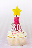 Thirtieth birthday cupcake Royalty Free Stock Photos