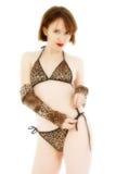 Thirty and Flirty. Beautiful thirty something year old woman in animal print bikini royalty free stock photos