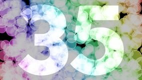Thirty four to thirty five years birthday fade in/out animation with color gradient moving bokeh background. Animation: 90 frames still with number, 180 fade vector illustration