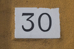 Thirty. Number Thirty on a house door royalty free stock photo