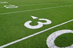 Thirty yard line. An empty high school football field Royalty Free Stock Photo