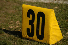 Thirty yard marker. A marker on the third yard line Royalty Free Stock Images