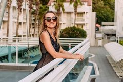 Thirty-year-old smiling Caucasian woman on the balcony of the hotel looking at the camera on vacation in the summer. Turkish hotel stock photography