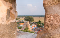 Thirumayam village seen through Battlements. Chettinad, India - October 16, 2013: View out of Thirumayam Fort through one battlements opening upon village and Stock Photography