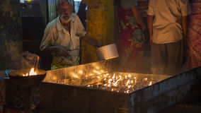 Thiruvannamalai , India – Oct, 2016: Indian Baba blessing peop. Thiruvannamalai, India – Oct, 2016: Indian Baba at the feast. Brahmin near hindu royalty free stock photos
