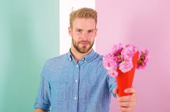 Free This Is For You Macho Gives Flowers As Romantic Gift. Boyfriend Confident Holds Bouquet Flowers. Man Ready For Romantic Stock Photos - 138447533