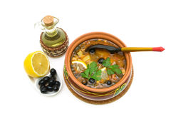 Thistle soup, olives, lemon and sunflower oil on a white background. royalty free stock photography